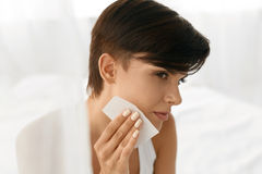 beauty-woman-cleaning-beautiful-fresh-skin-absorbing-tissue-perfect-oil-sheets-closeup-portrait-healthy-girl-nude-74382425