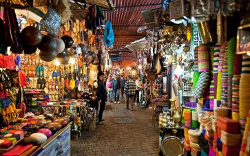 Marrakech, Morocco- February 22, 2016: Moorish bazaar and narrow alleyways of the Souk, with a view into the market areas showing the incredible variety of wares for sale, Marrakech, Morocco