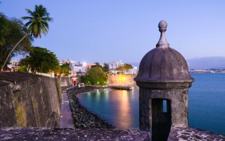 Turret along Old San Juan Wall in Puerto Rico at night.